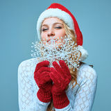 Beautiful young woman in Santa Claus clothes with Stock Photography