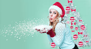Beautiful young woman in Santa Claus clothes with snowflakes Royalty Free Stock Photos