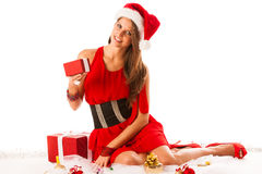 Beautiful young woman in santa claus dress sitting on the flor i Royalty Free Stock Photography