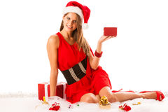 Beautiful young woman in santa claus dress sitting on the flor i Royalty Free Stock Images