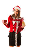 Beautiful young woman in santa claus dress standing isolated ove Royalty Free Stock Image