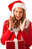 Beautiful young woman in santa claus dress standing isolated ove Stock Photo