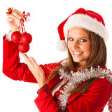Beautiful young woman in santa claus dress standing isolated ove Stock Images