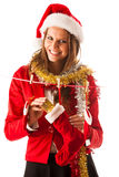 Beautiful young woman in santa claus dress standing isolated ove Royalty Free Stock Photos