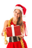Beautiful young woman in santa claus dress standing isolated ove Stock Photography