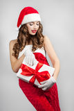 Beautiful young woman in a Santa Claus hat. Royalty Free Stock Photos