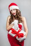 Beautiful young woman in a Santa Claus hat. Royalty Free Stock Images