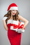 Beautiful young woman in a Santa Claus hat. Stock Photo