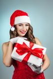 Beautiful young woman in a Santa Claus hat. Stock Photos