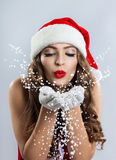 Beautiful young woman in a Santa Claus hat. stock image