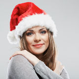 Beautiful young woman Santa Claus hat close up fac Stock Photo