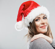 Beautiful young woman Santa Claus hat close up fac Stock Photography