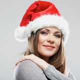 Beautiful young woman Santa Claus hat close up face portrait. Stock Images