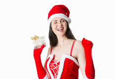 Beautiful young woman in Santa Clause costume holding Christmas present. Stock Images
