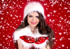 Beautiful young woman in santa clothes Stock Image