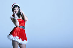 Beautiful young woman in Santa costume Stock Photo