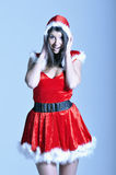 Beautiful young woman in Santa costume Stock Images
