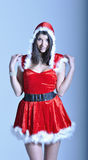 Beautiful young woman in Santa costume Royalty Free Stock Photos
