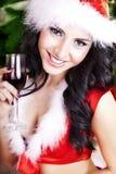 Beautiful young woman on santa hat royalty free stock photo