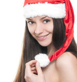 Beautiful young woman in santa hat. On white background royalty free stock photography
