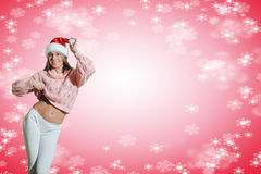 Beautiful young woman in Santa hat dancing on Royalty Free Stock Image