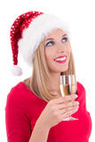 Beautiful young woman in santa hat dreaming with glass of champa Royalty Free Stock Image