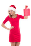 Beautiful young woman in santa hat with gift bag isolated on whi Stock Images