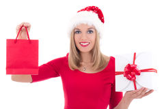Beautiful young woman in santa hat with gifts isolated on white Stock Photography