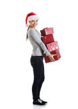 Beautiful young woman in santa hat with presents. Stock Images