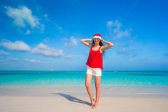 Beautiful young woman in santa hat on tropical Stock Image