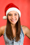 Beautiful young woman with Santa`s Hat Royalty Free Stock Image