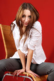 Beautiful young woman sat on a chair Royalty Free Stock Image