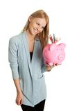 Beautiful young woman saving money Stock Image