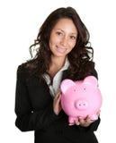 Beautiful young woman saving money Royalty Free Stock Photos