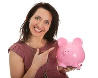 Beautiful young woman saving money Royalty Free Stock Image