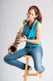 Beautiful young woman saxophone player Royalty Free Stock Photos