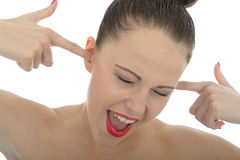 Beautiful Young woman Screaming With Her Fingers In Her Ears Not Royalty Free Stock Photos