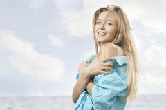 Beautiful young woman at the sea Royalty Free Stock Images