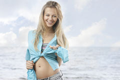 Beautiful young woman at the sea Stock Photo