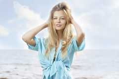 Beautiful young woman at the sea Stock Photos