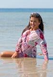 Beautiful young woman in sea Stock Photo