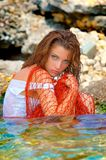 Beautiful young woman in the sea Stock Photos
