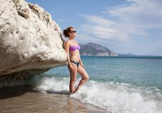 Beautiful young woman and sea Royalty Free Stock Images