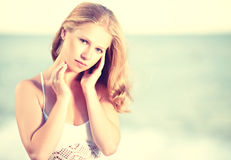 Beautiful young woman on the sea, ocean Royalty Free Stock Image