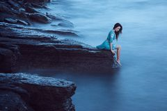 Beautiful young woman on sea royalty free stock photography