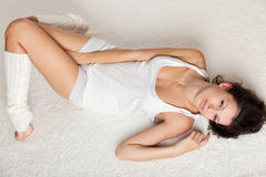 Beautiful young woman seductively lying on floor Stock Images
