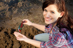 Beautiful young woman with seeds Stock Photography