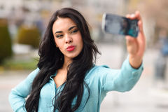 Beautiful young woman selfie in the park Royalty Free Stock Photo