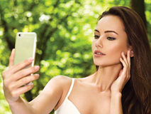 Beautiful young woman selfie in the park Royalty Free Stock Image