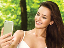 Beautiful young woman selfie in the park Stock Photo